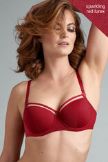Steal the show in this sparkling red balcony bra. The Sparkly fabric is sprinkled with shinny laminated glitters and it contrasts beautifully with your skin tone. The playful straps on top of the cups adorn your décolleté. The padding of this red bra gives you extra support, and wires enclosing the entire breast create a modest cleavage. Look to its matchy-matchy bottoms to complete the set and start shining.