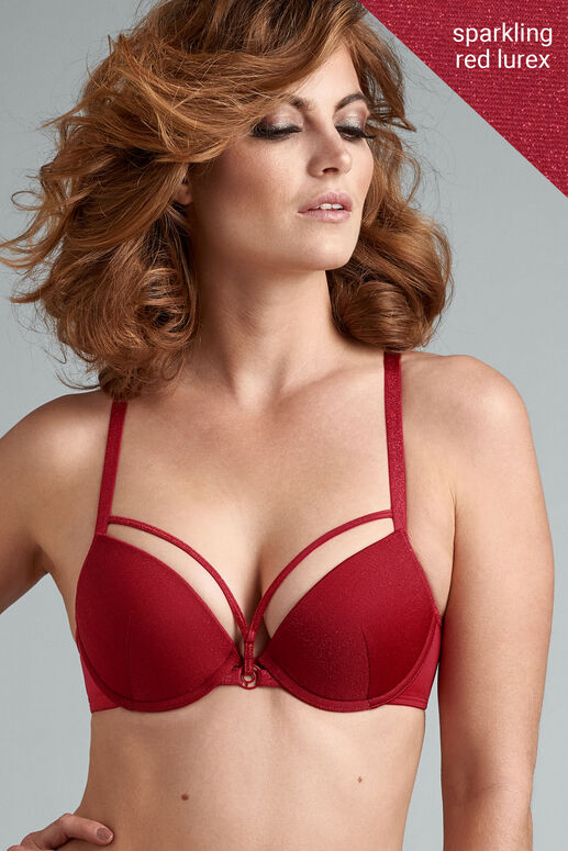 This sparkling red push up bra is a must have in your wardrobe. This soft elastic fabric has been decorated with a shimmering red touch. Decorate your cleavage with glittery finished red straps on top of the cups. As a finishing touch this bra has space ship inspired ornaments on the bindings. Let's not forget the perfect padding that gives you extra support while giving you a dazzlingly deep cleavage. Wear this sparkly bra and dare to be a woman with a mission!